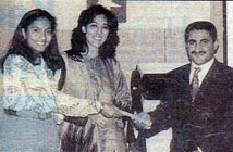 Poonam Datta Maersk Line and Michelle Mascarenhas Polaris, presenting a prize to Ali.