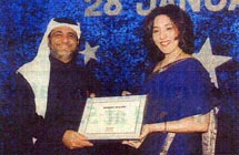Salim Altoki of freight forwarders Altoki Group receiving his award from Maersk UAE, Qatar and Oman Managing Director Poonam Datta